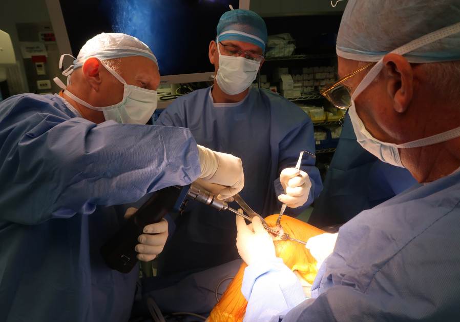 octors at Hadassah Hospital perform the surgery to insert Agili-C into a patient's heal