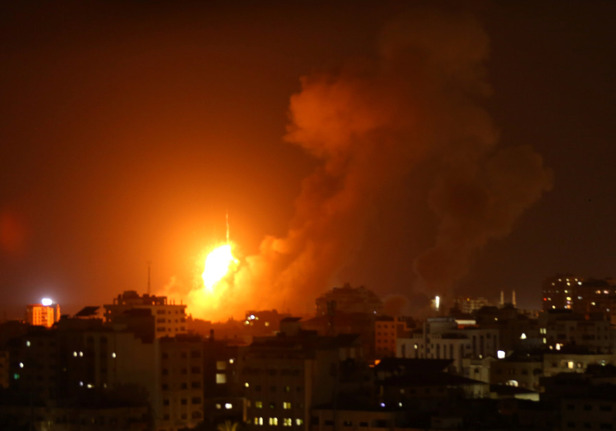 An explosion is seen during an Israeli air strike in Gaza City August 8, 2018.