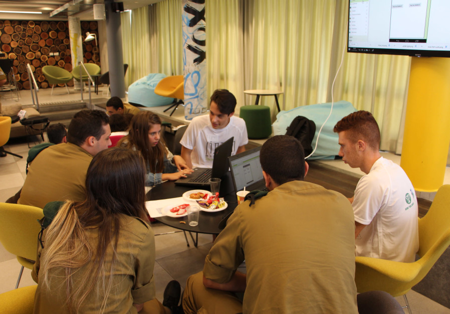 Teens work together to develop an app at the KKL-JNF House for Excellence