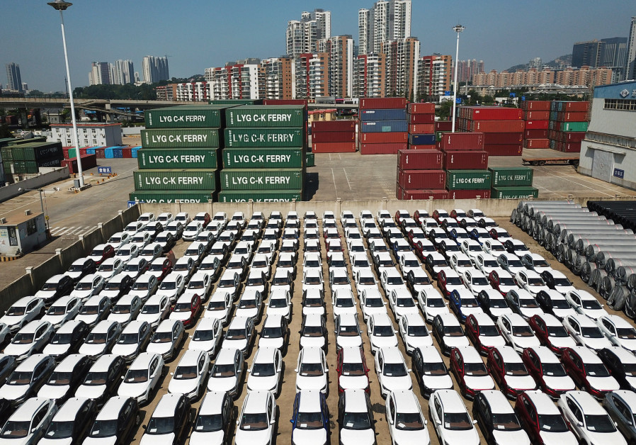 Cars to be exported sit at a port in Lianyungang, Jiangsu province, China, 2018