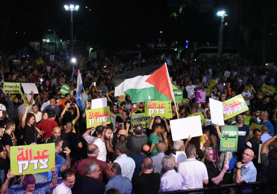 Palestinian flags flutter at a protest against the Nation-State Law in Rabin Square, Tel Aviv