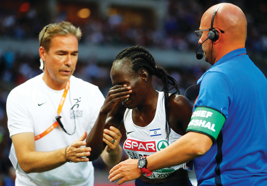 ISRAELI RUNNER Lonah Chemtai Salpeter (center) breaks down in tears after a mental error in the penu