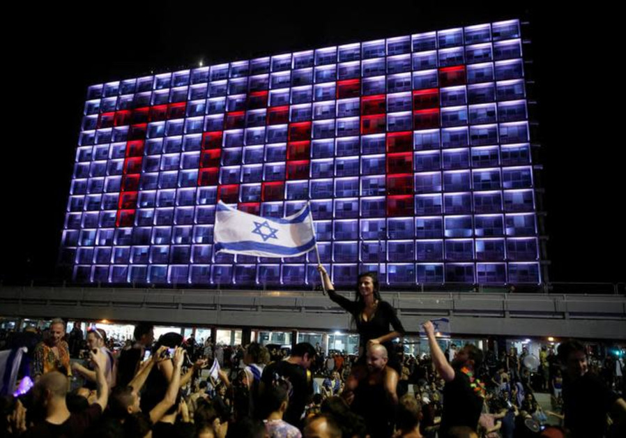 People celebrate the winning of the Eurovision Song Contest 2018 by Israel's Netta Barzilai