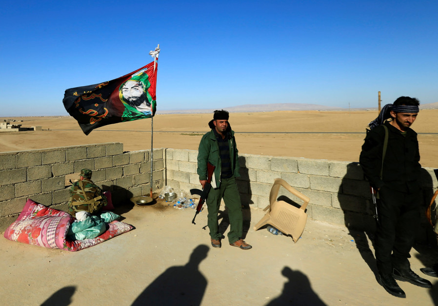 Members of a Shia militia guard a house in Iraq. The new NDAA warned about the presence of Irania