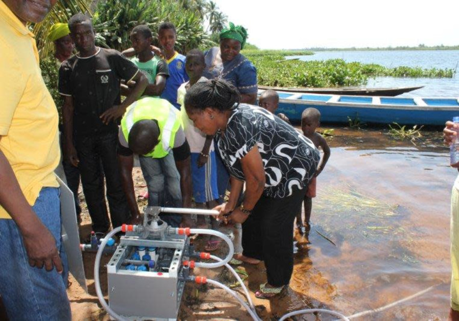 NUF water purification system in operation at a contaminated water source in Africa.