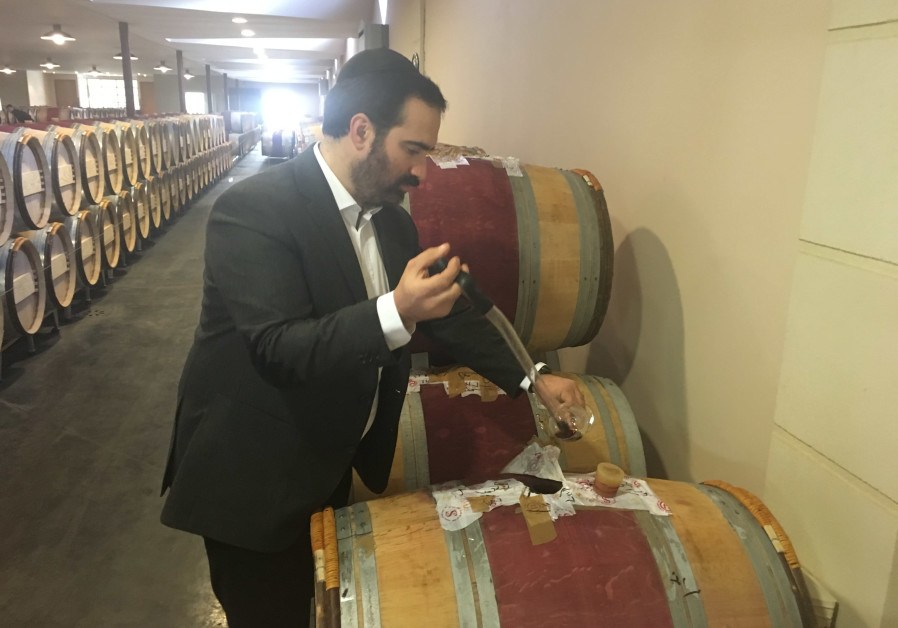 Menahem Israelievitch taking a barrel sample. (Courtesy)