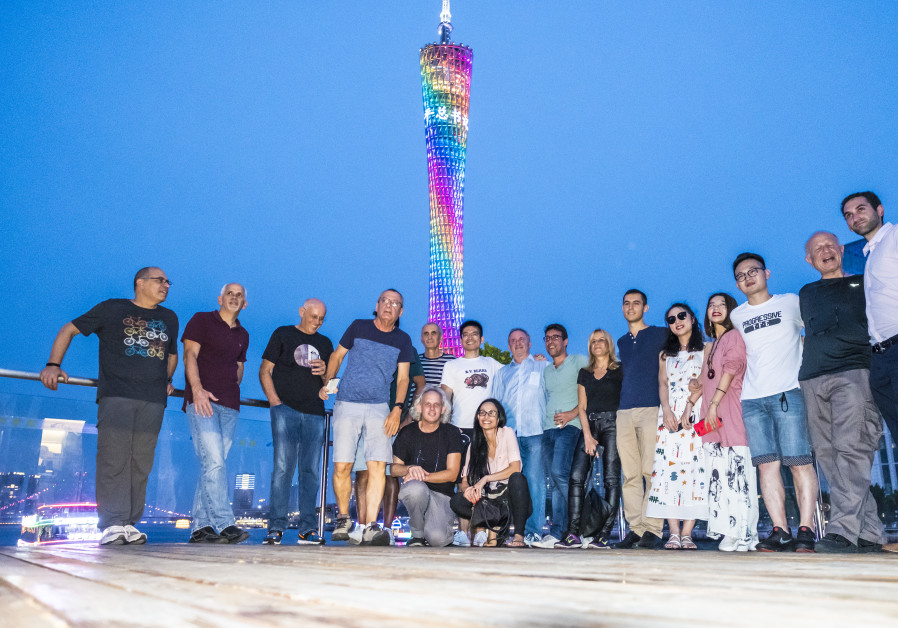 THE ISRAELI JOURNALISTS pose for a photo with their Chinese hosts  at the Canton Tower