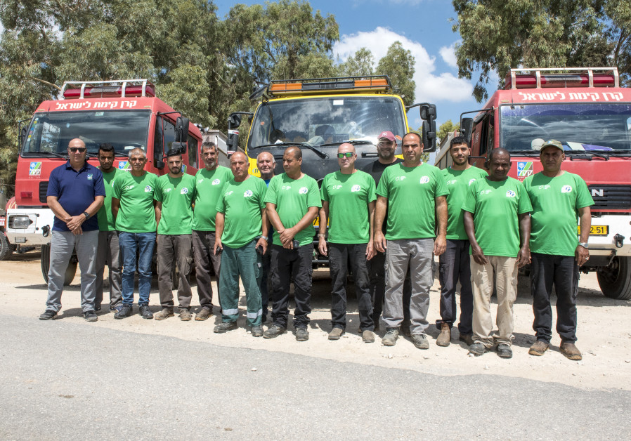 KKL-JNF Western Negev firefighters try on the special moisture-proof t-shirts from JNF USA