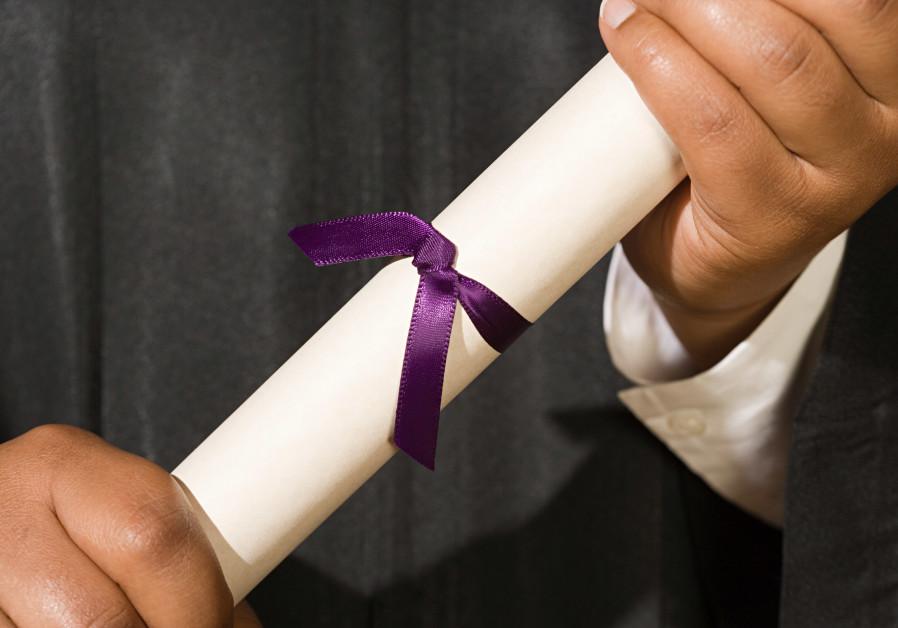 Graduate holding diploma, graduation