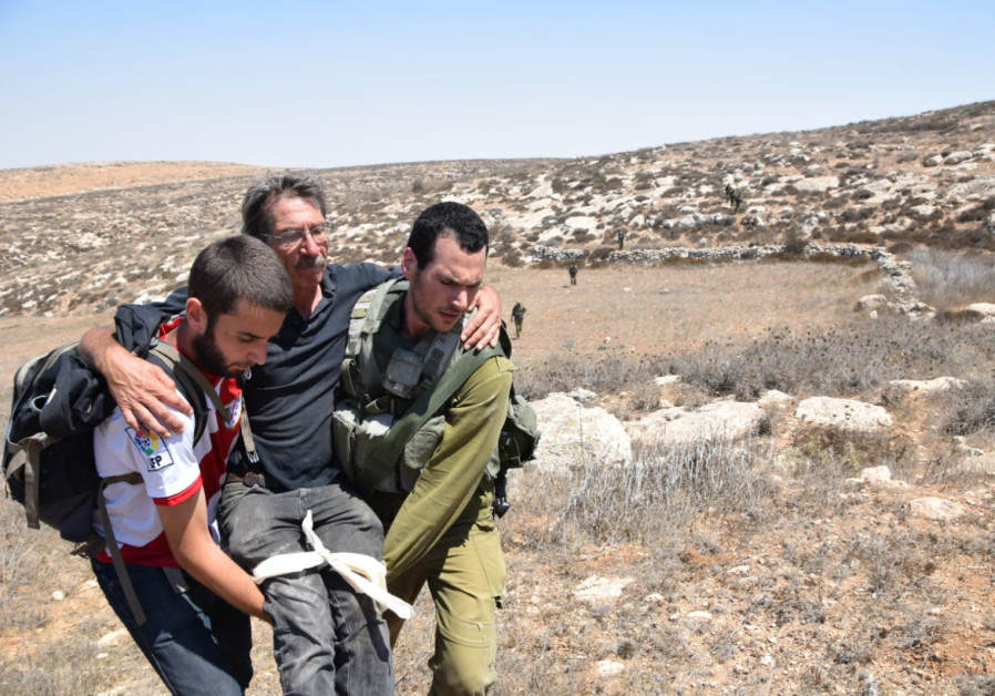 Left-wing activist evacuated after confrontation with settlers, Aug 25, 2018
