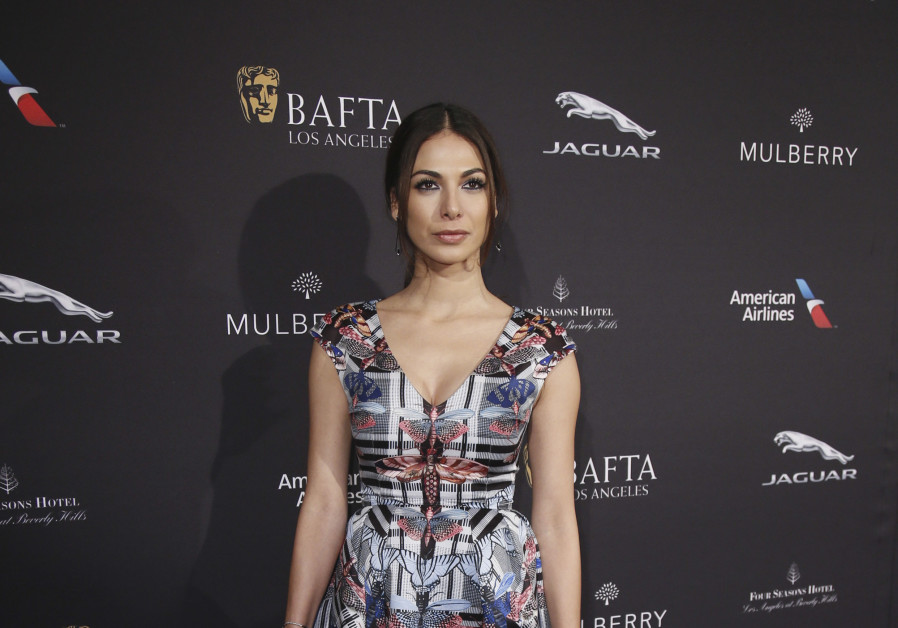 Actress Moran Atias poses at the British Academy of Film and Television Arts (BAFTA) Los Angeles 2015 Awards season tea party in Beverly Hills, California January 10, 2015.