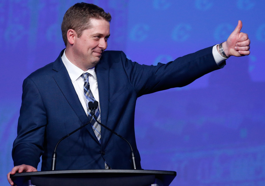 Andrew Scheer celebrates after winning the leadership during the Conservative Party of Canada leader
