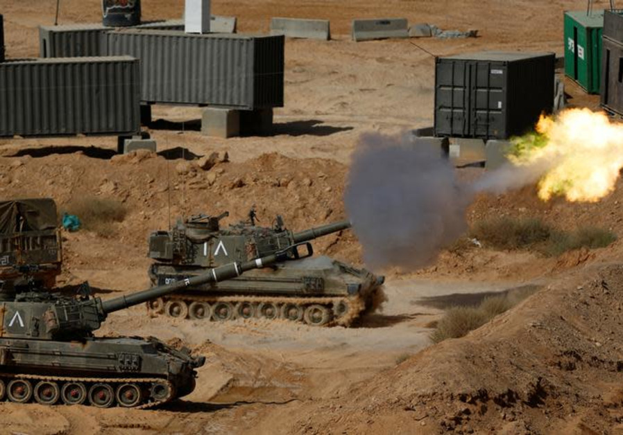 An Israeli mobile artillery unit fires during a combined forces drill in Shizafon military base