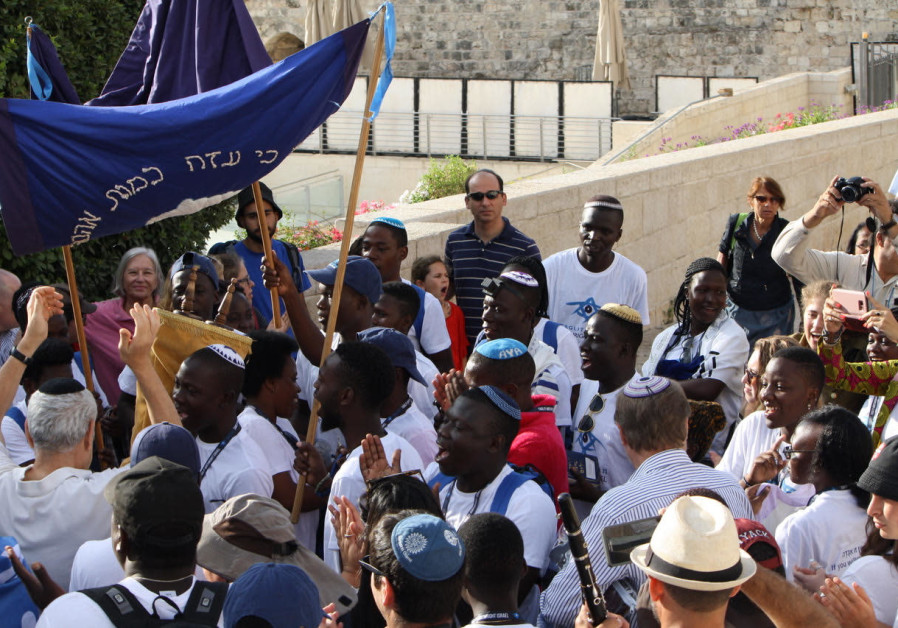 Ugandan Birthright visitors rejoice with Torah at the Western Wall