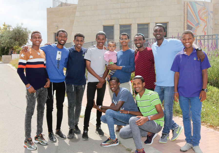The eight Ethiopian young men who came to Israel to study Torah, with their counselor (holding baby)