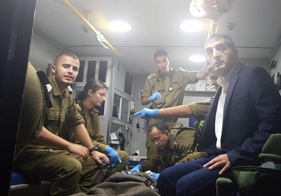 SHEBA MEDICAL CENTER Director General, Prof. Yitshak Kreiss and IDF combat medics transport a severe