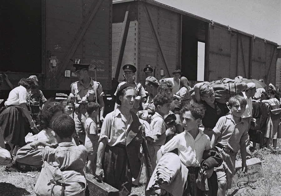 YOUNG HOLOCAUST survivors arrive at the Atlit detainee camp, 1945.