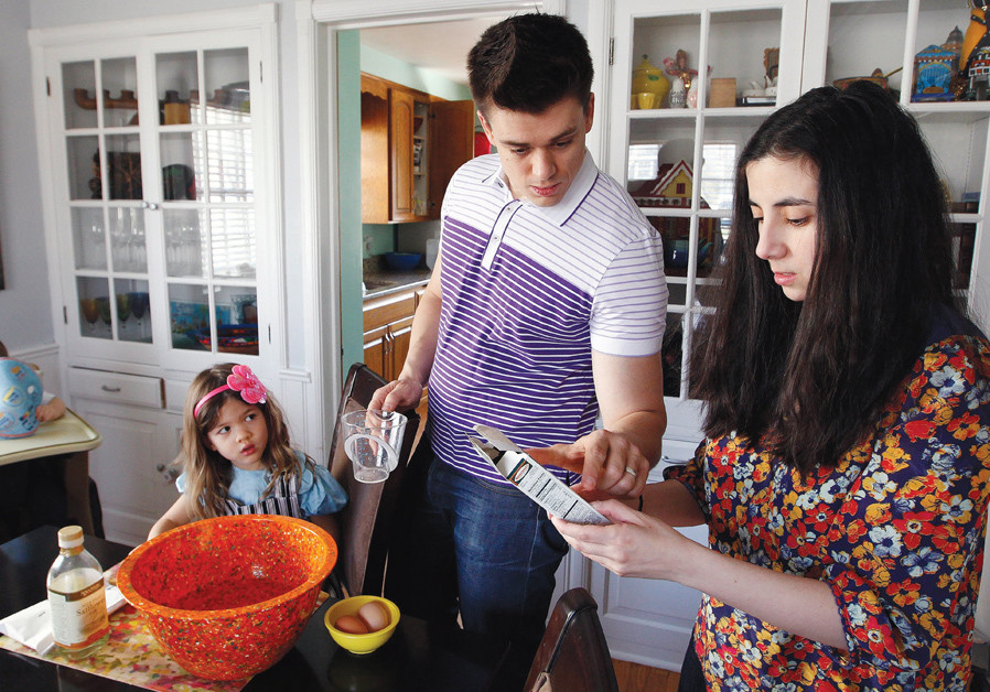 A FAMILY prepares for Passover at their home in Wisconsin.
