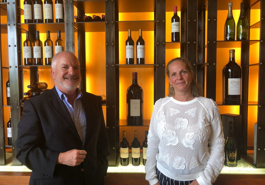 Baroness Ariane de Rothschild and Adam Montefiore standing in front of the EDR Heritage wines. (Credit: Courtesy)
