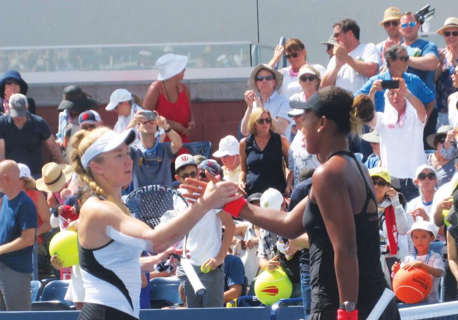 ISRAEL'S JULIA GLUSHKO (left) shakes hands at the net with Japan's Naomi Osaka