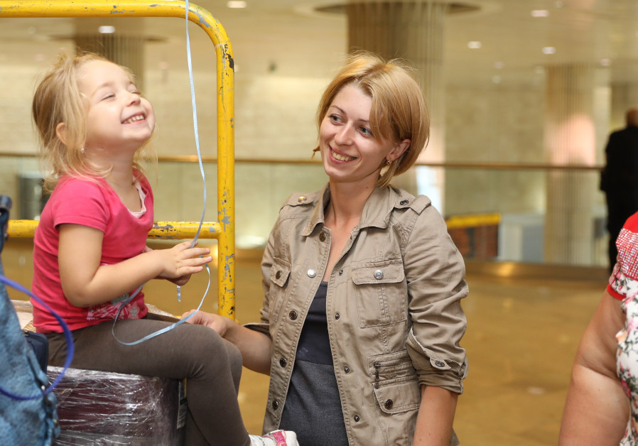 A mother and daughter from Ukraine arrive at Ben Gurion airport last week courtesy of International