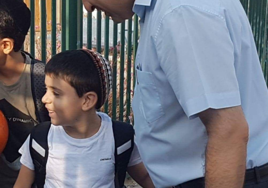 Jerusalem Affairs Minister Ze'ev Elkin takes his son Ariel to 3rd grade at his new school in the capital's Pisgat Ze'ev neighborhood