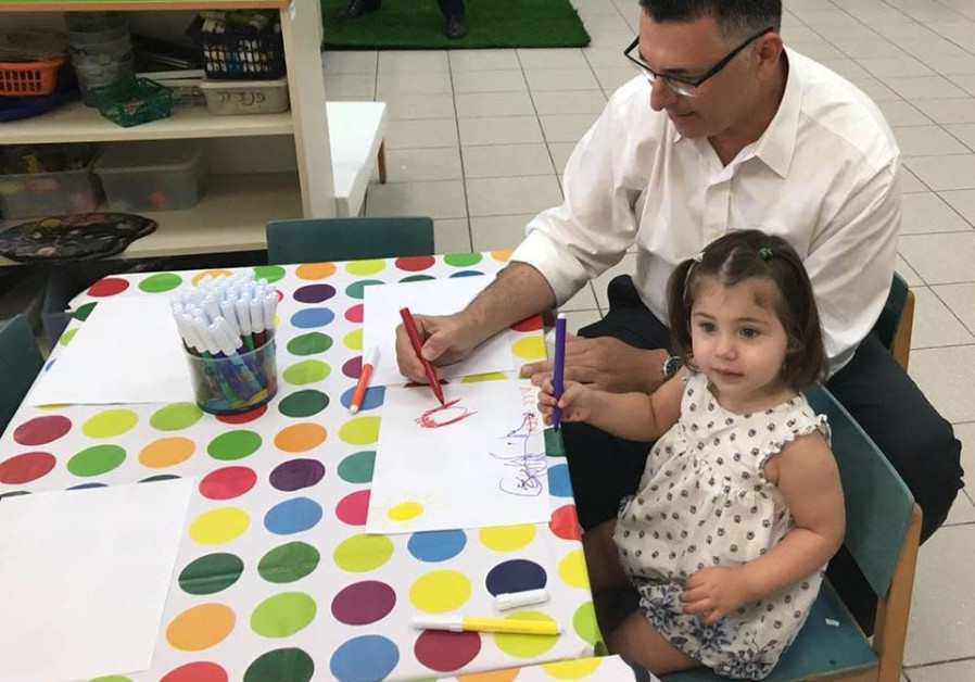 Former ninister Gideon Saar takes his daughter Shira to nursery school in Tel Aviv (Courtesy)