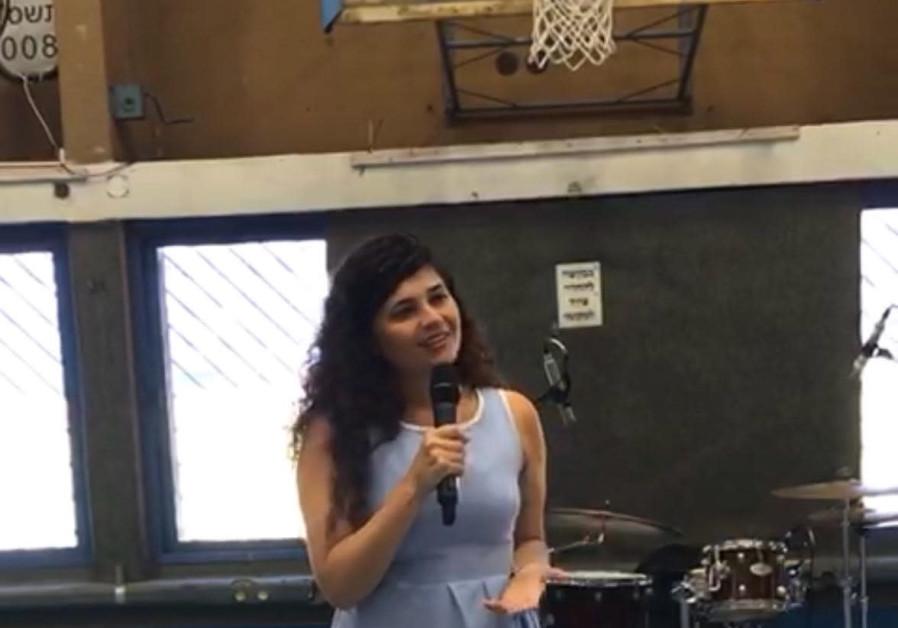 Likud MK Sharren Haskel speaks at the high school she attended in Kfar Saba