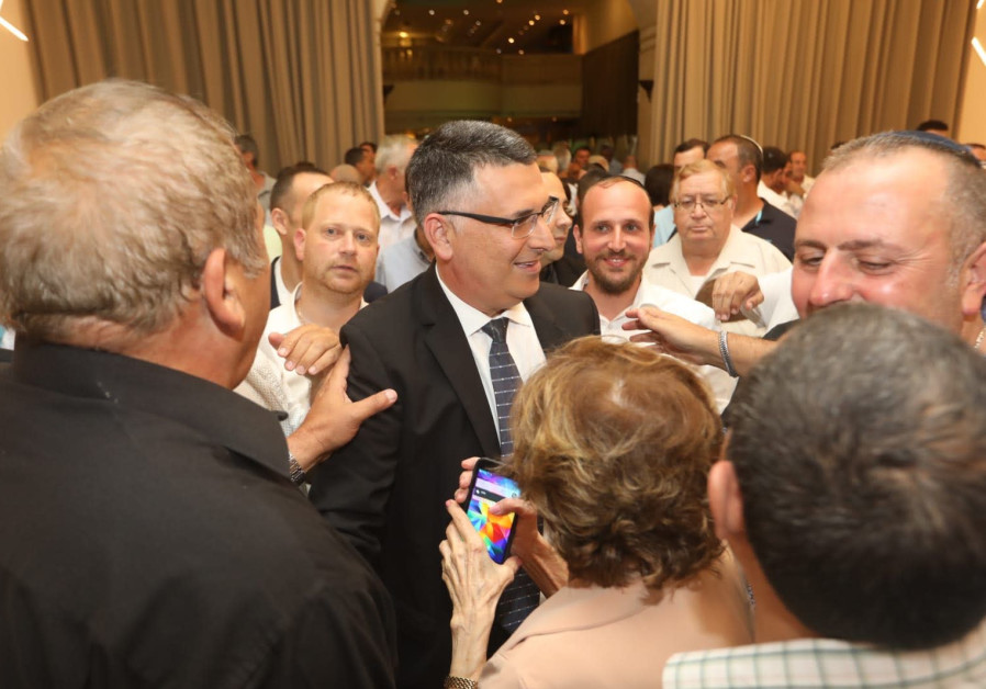 Fans of former minister Gideon Sa'ar swarm him at a pre Rosh Hashana toast he hosted