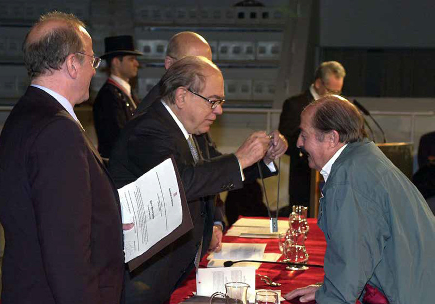 ENRIC MARCO receives the Creu de Sant Jordi Award in 2001, four years before his web of lies began t