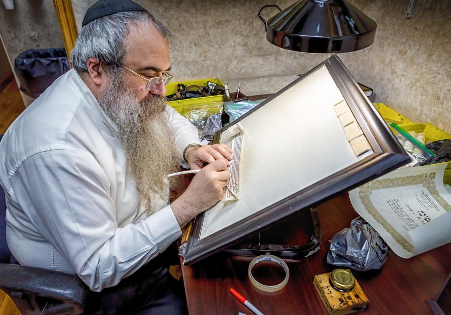 Rabbi Faitel Lewin busy at work.