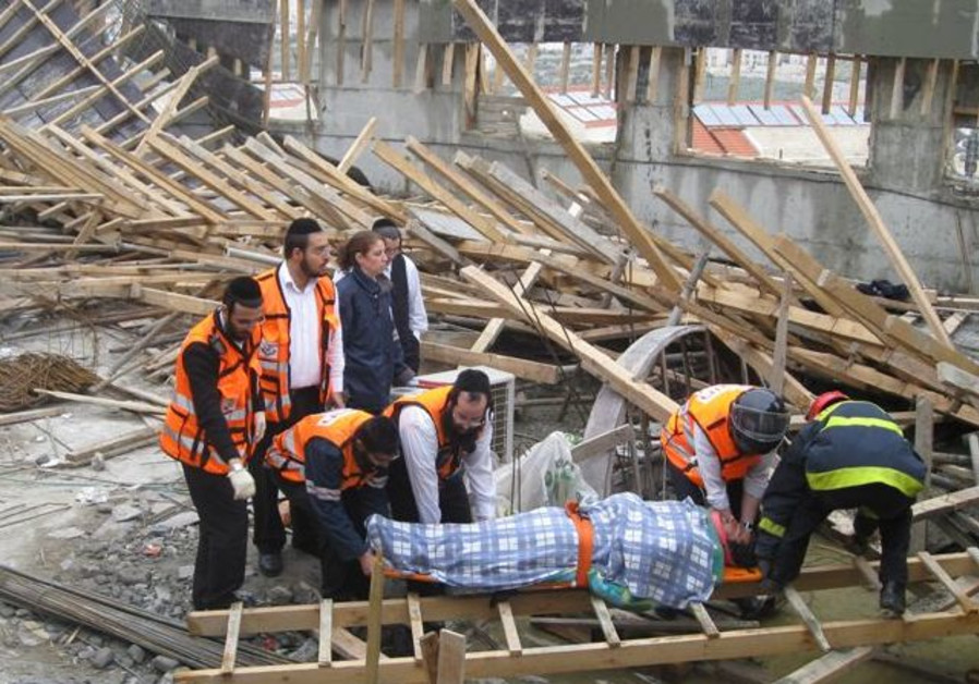United Hatzalah volunteers working to save lives after a building collapsed.