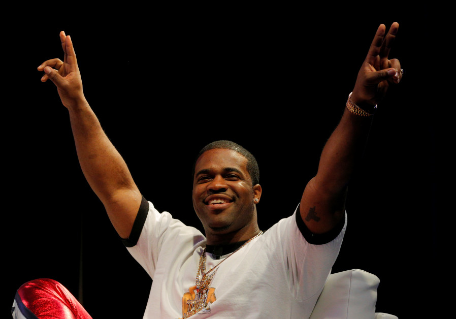 Rapper ASAP Ferg acknowledges the crowd as he is introduced for a panel discussion at the South by S