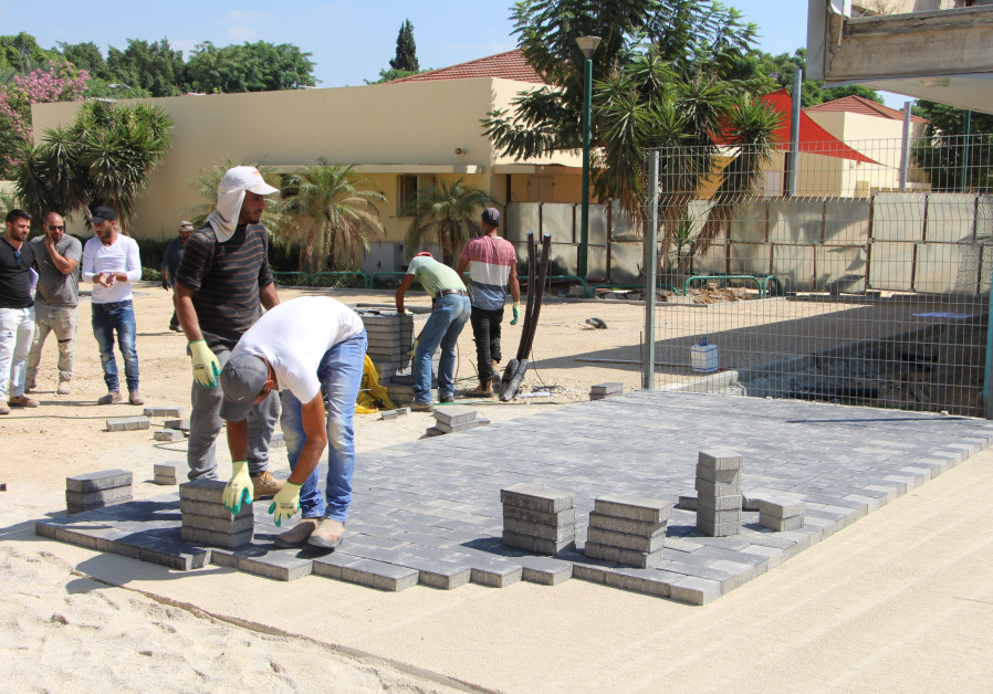 Constructing a courtyard at the reinforced elementary school in Sha'ar Hanegev.