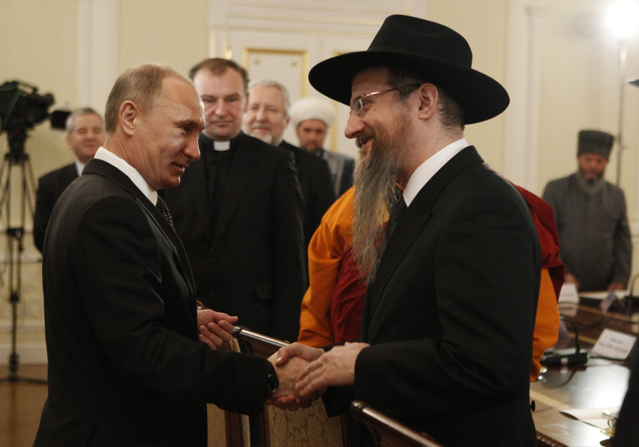 Vladimir Putin shakes hands with Russia's Chief Rabbi Berel Lazar (February 8, 2012).
