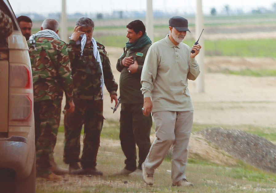 IRANIAN REVOLUTIONARY Guards Corps commander Qassem Soleimani uses a walkie-talkie