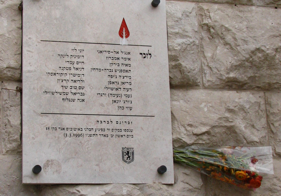 A plaque commemorates the victims— 16 civillians and three soldiers— of the No. 18 bus bombing