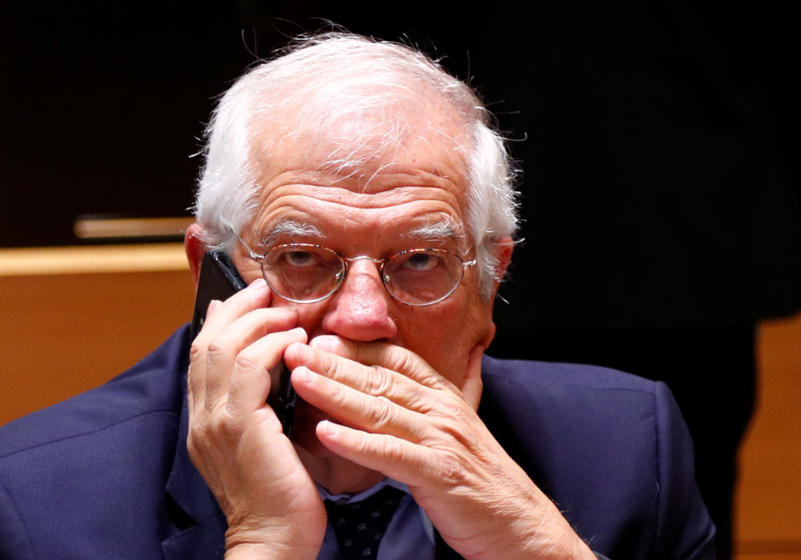 Spain's Foreign Minister Josep Borrell speaks on his mobile phone at the start of a European Union