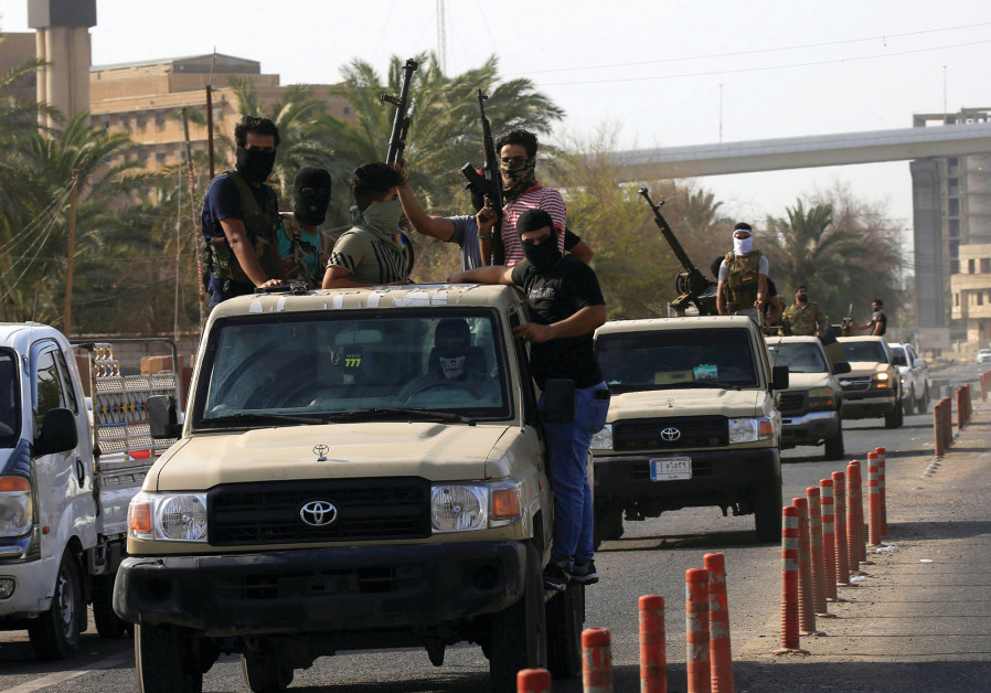 VEHICLES OF Iraq's Popular Mobilization Forces patrol the streets of Basra last week.