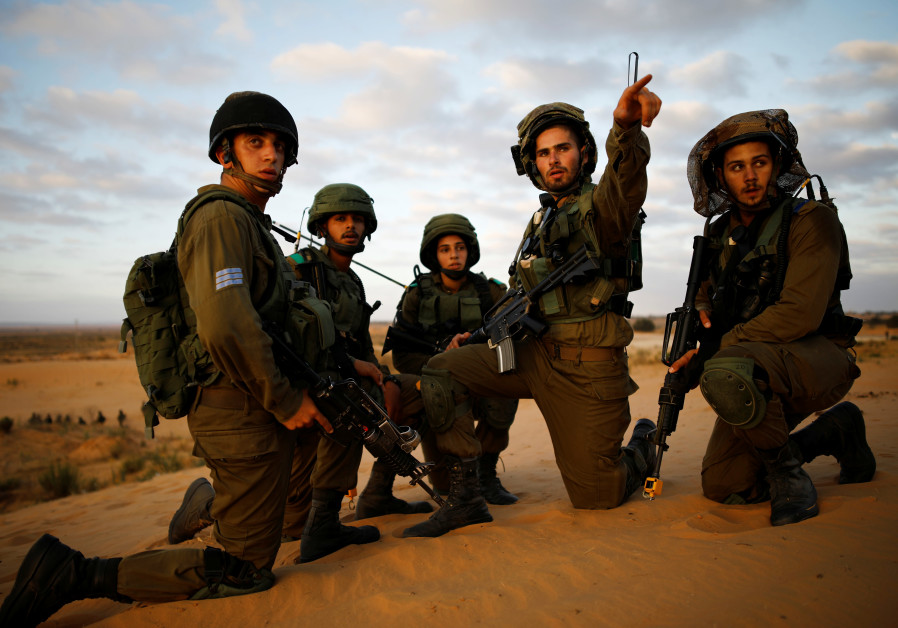 Israeli soldiers from the Home Front Command Unit gather as they take part in an urban warfare drill