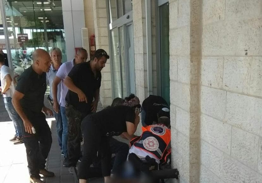 Paramedics attempt to save terrorist victim near Gush Etzion, September 16, 2018