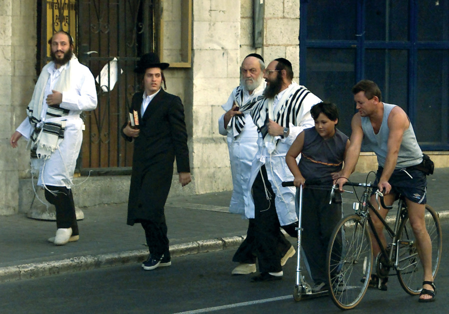 Bike-riders and synagogue-goers. 'I don't really miss doing the full ultra-Orthodox Yom Kippur because I don't really feel the need to check off all the boxes or anything. For me it's more important to just commemorate the day and have the feel of Yom Kippur,' says Dovid. (Reuters)
