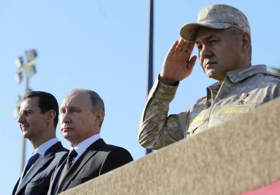 Russian President Vladimir Putin (C), Defence Minister Sergei Shoigu (R) and Syrian President Basha
