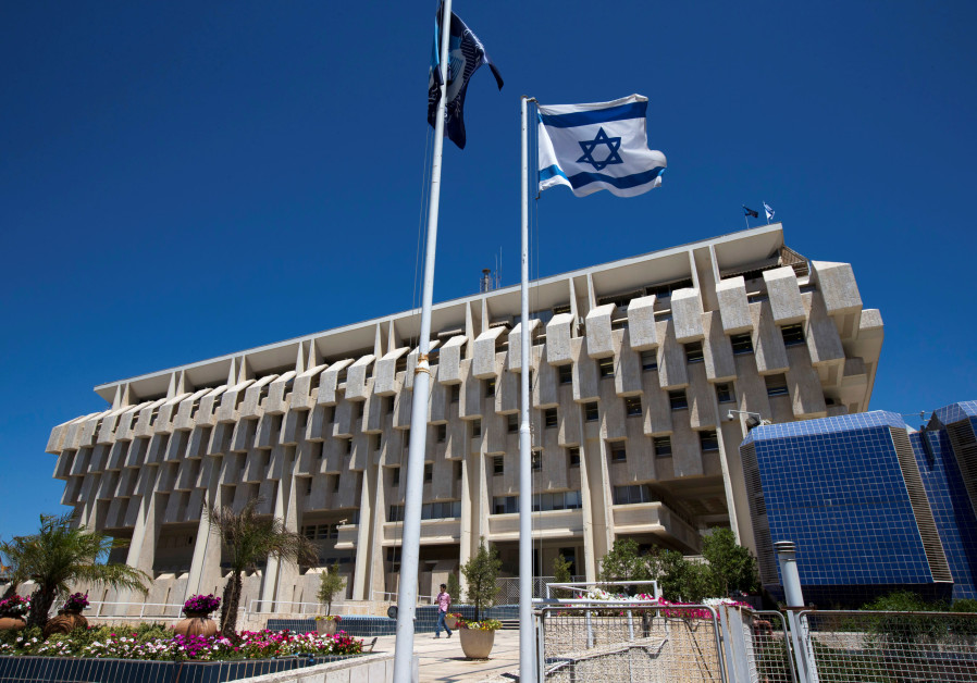 An Israeli flag flutters outside the Bank of Israel building in Jerusalem August 7, 2013