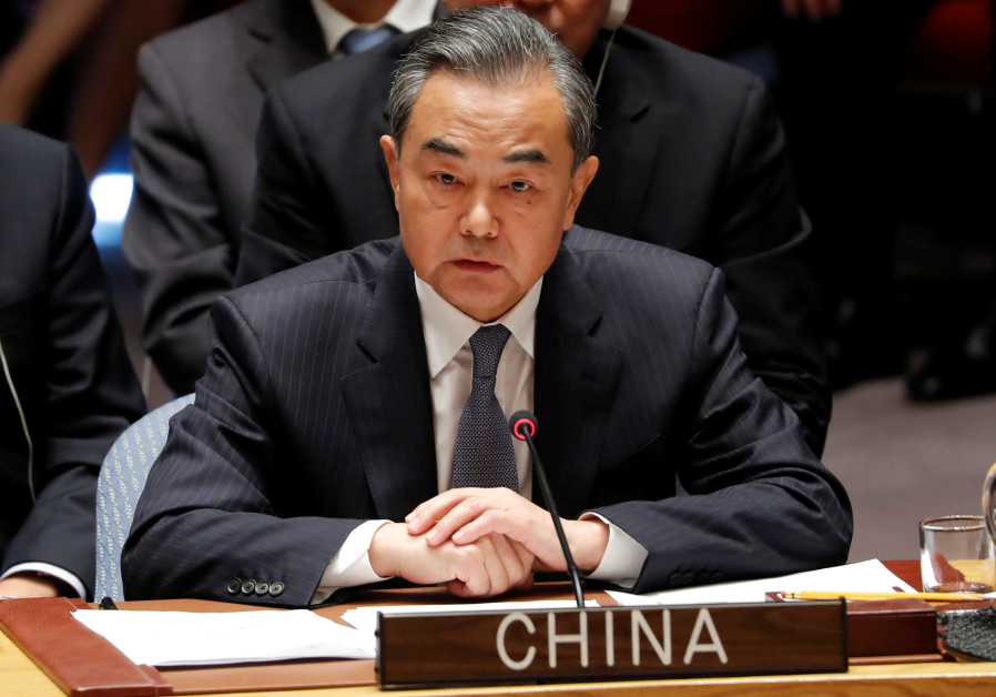 China's Foreign Minister Wang Yi listens to President Donald Trump address a UN Security Council
