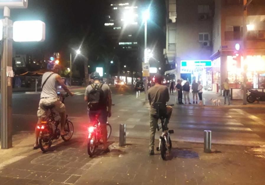 Electric bicyclists use a bike path on Ibn Gvirol, Tel Aviv on Tuesday.