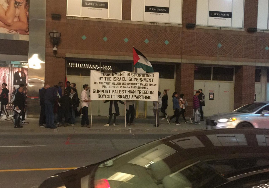 PROTESTERS HOLD a sign outside the Gesher Theater's show in Toronto over the weekend