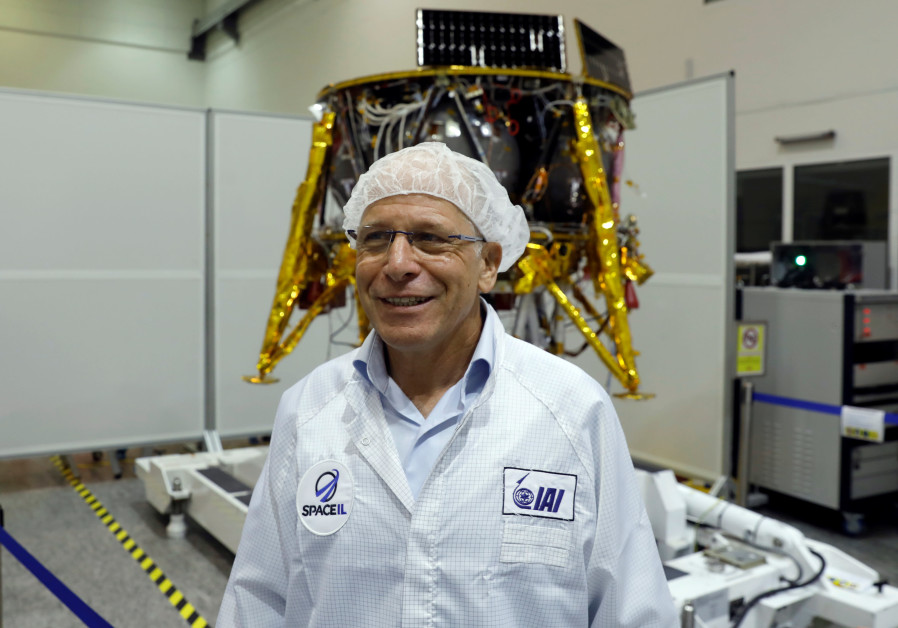 Ido Anteby, SpaceIL's CEO stands in front of an unmanned spacecraft.