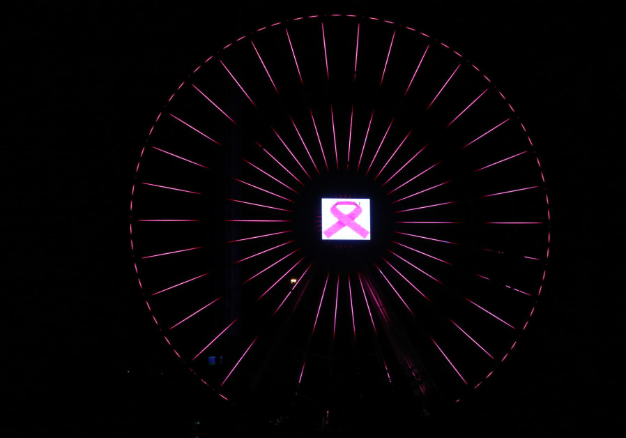 The ferris wheel of Luna Park Tel Aviv glows pink in honor of Breast Cancer Awareness Month, 2018