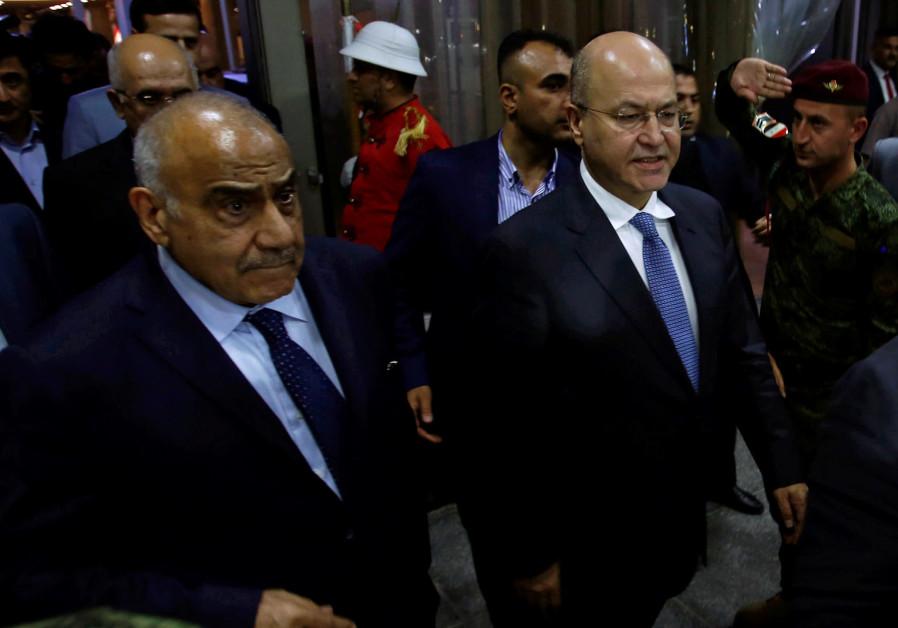 Barham Salih, Iraq's newly elected president, walks with Iraq's new Prime Minister Adel Abdul Mahdi
